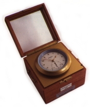 image of a small chronometer in a wooden box